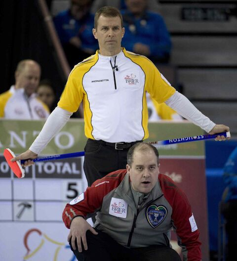 Manitoba skip Jeff Stoughton (rear) and N.W.T. skip Jamie Koe like the upcoming changes.