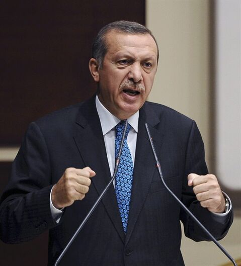 Turkish Prime Minister Recep Tayyip Erdogan addresses his party members in Ankara, Turkey, Friday, June 14, 2013. Erdogan said he has asked a small delegation of protesters to convince those occupying a park to withdraw, adding that he is hopeful their protest action would end later in the day.(AP Photo)
