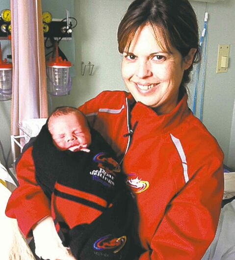 Tara Smith with her newborn son, Rory Wray Taylor.