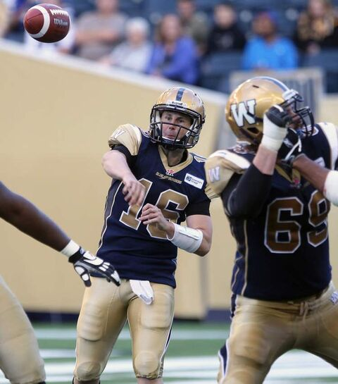 Winnipeg Blue Bombers quarterback Max Hall heaves a pass during second-quarter action at Investors Group Field on Wednesday night.