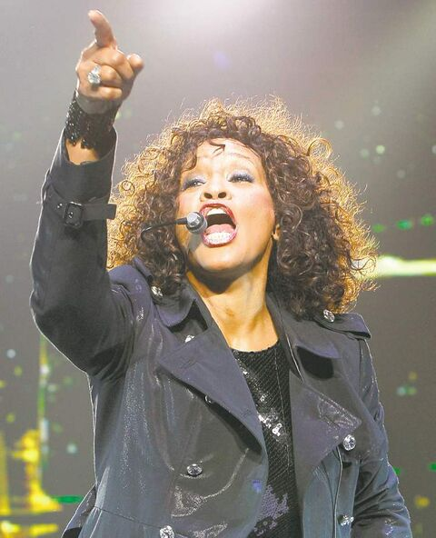 U.S. singer Whitney Houston performs at Saitama Arena in Saitama, near Tokyo, Japan, Thursday, Feb. 11, 2010. (AP Photo/Shizuo Kambayashi) ** EDITORIAL USE ONLY,  ONE TIME USE ONLY **
