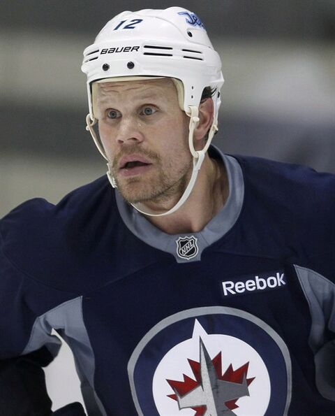 Winnipeg Jets' Olli Jokinen (12), from Finland, on the third day of NHL hockey training camp Friday, September 13, 2013 in Winnipeg. THE CANADIAN PRESS/John Woods