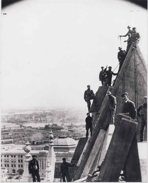 Workers sheathe with copper the roof of the Fort Garry Hotel in 1914. The Prairie economy had stalled and the city was flooded with unemployed men.