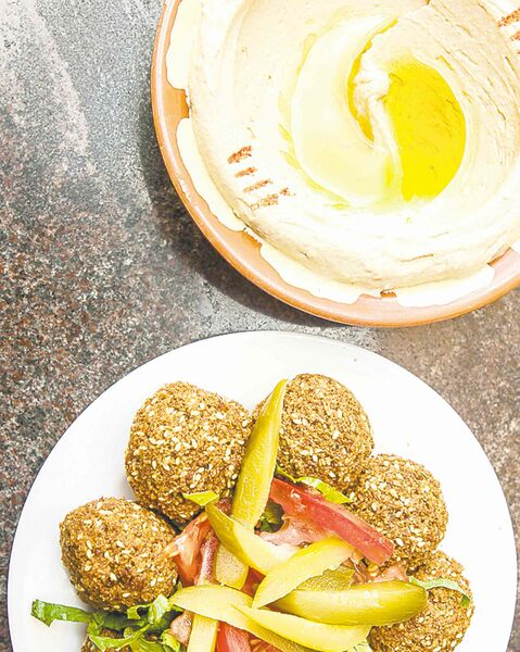 Plates of falafels and hummus from Lebanese Flower, Defence Road, Abu Dhabi.