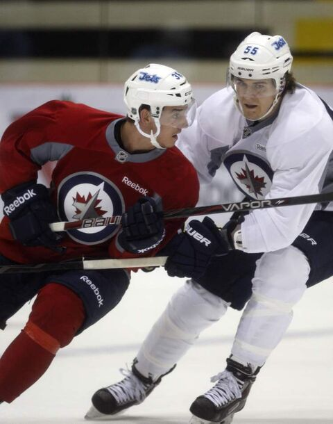 Mark Scheifele (right) checks a shifty Nic Petan at the Winnipeg Jets development camp on Friday.