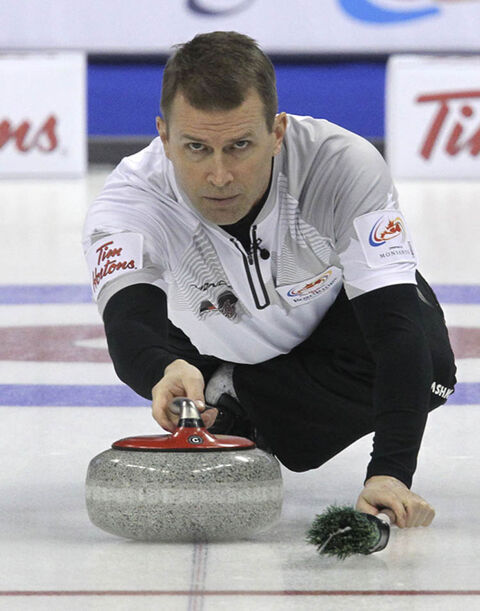 Skip Jeff Stoughton throws a rock during a game against Team Martin Monday afternoon during the Roar of the Rings.