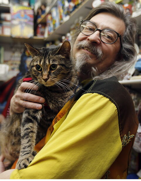 Larry Jensen holds Eddie the now-slimmer fat cat. Don't worry. You can still keep track of Eddie and his weight-loss progress on his new Facebook page.