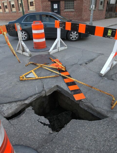 The latest sinkhole to develop at Princess Street and Alexander Avenue Friday night.