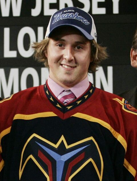 Alex Bourret of Drummondville, Que. tries on his Atlanta Thrashers jersey during the first round draft pick at the NHL entry draft in Ottawa in 2005. His 16th-overall selection in the first round was one of only two times the Thrashers/Jets organization picked later than 13th in the draft. Since being drafted, Bourret has yet to crack an NHL lineup.
