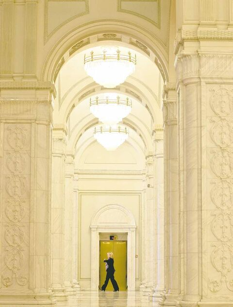 A woman walks inside the Parliament Palace in Bucharest, Romania.