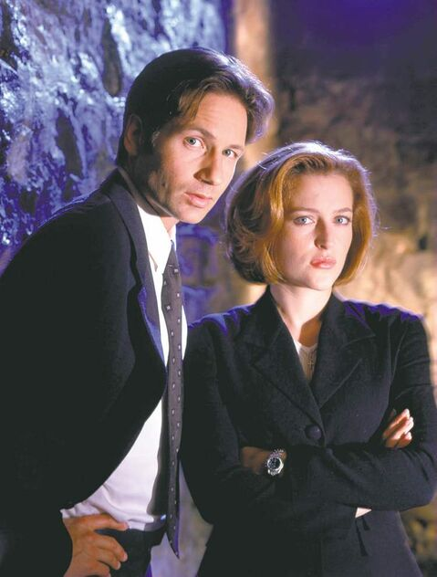 David Duchovny (left) as Agent Fox Mulder and Gillian Anderson as Agent Dana Scully.