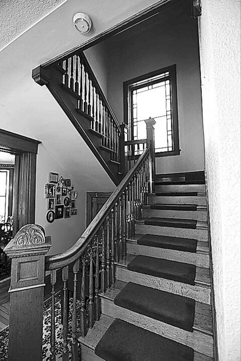 The hand-crafted staircase to the upper level.