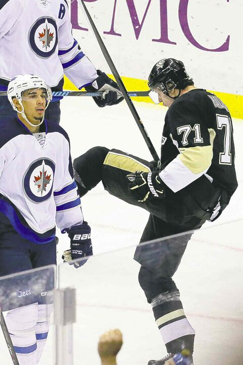 Evgeni Malkin scored on two Byfuglien turnovers Sunday: Here, he's celebrating his second.