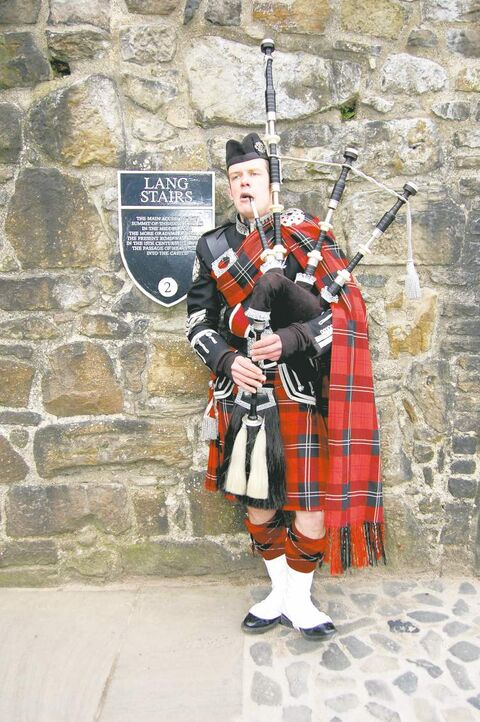 Roddy the Piper led us into Edinburgh Castle for a private dinner in the Queen Anne Room.