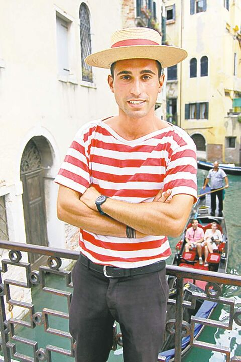 Gondolier Nicolas Trevesan awaits customers on the Campo San Provolo Bridge over the Rio Del Vin Canal.