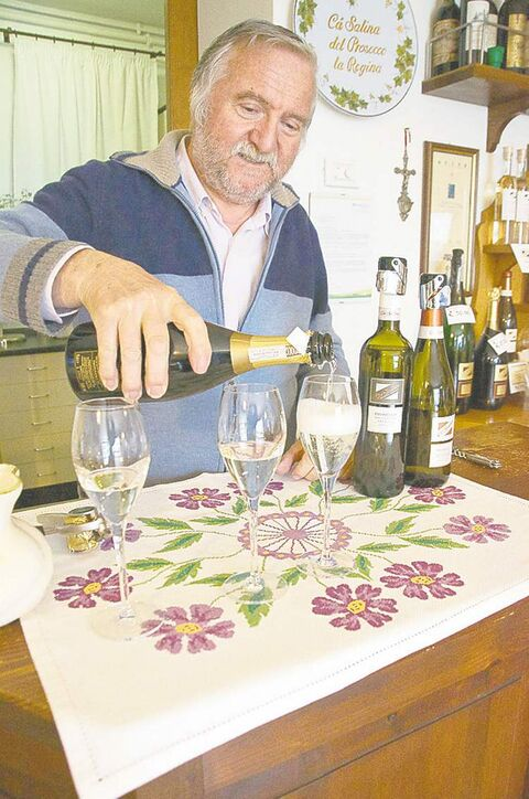Gregorio Bortolin, owner of Ca' Salina winery, pours samplings of the various types of prosecco.