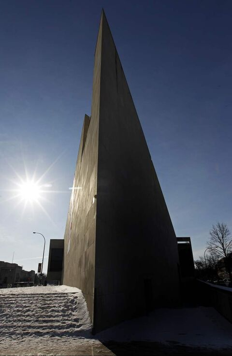 The sun lights up one side of the Winnipeg Art Gallery while the other is cast in shadow in a file photo.