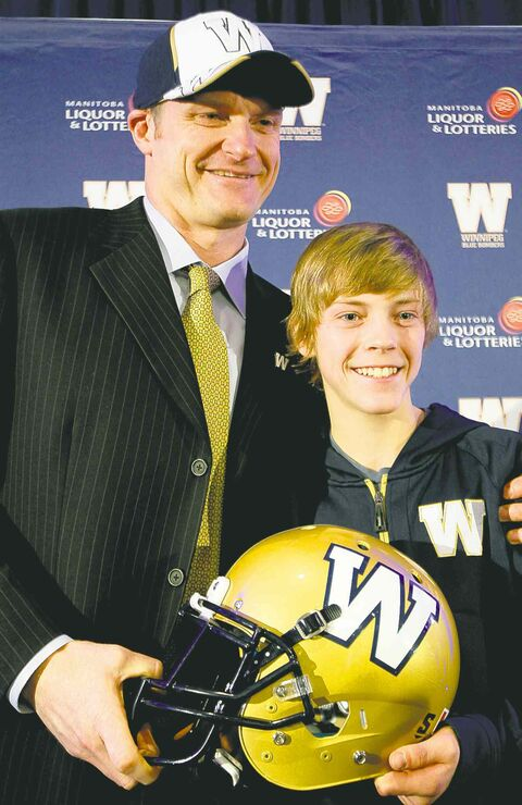 New Bomber coach Mike O'Shea's 13-year-old son, Michael, joined him on the podium Wednesday.