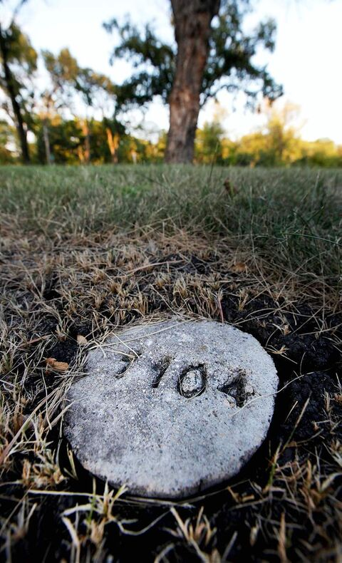 A stone marks Phoenix Sinclair's grave. Her killers -- her mom and stepdad -- had two children together.