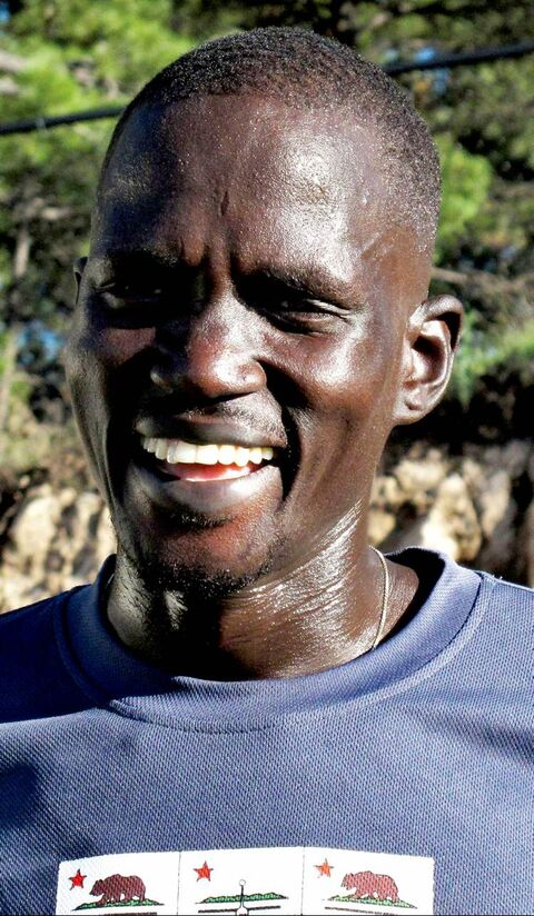 Guor Marial, 28, takes a break from running drills in Flagstaff, Ariz. The Sudanese refugee learned just weeks ago that he could compete in the men�s marathon at the Olympics as an independent athlete.