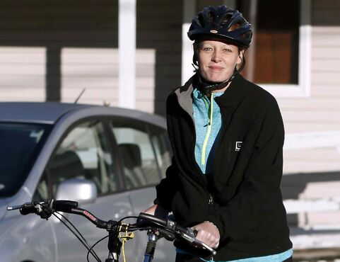Nurse Kaci Hickox leaves her home on a rural road in Fort Kent, Maine, Thursday. State officials are going to court to keep Hickox in quarantine for the remainder of the 21-day incubation period for Ebola that ends on Nov. 10. Police are monitoring her, but can't detain her without a court order.