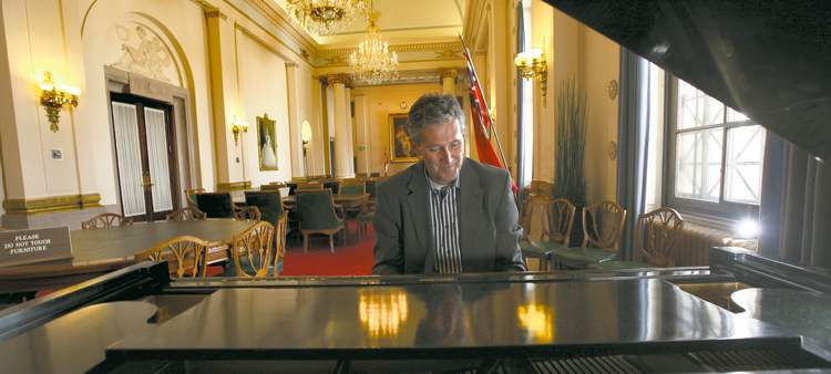 An avid piano player, Pallister takes the opportunity to tickle the ivories in a lounge in the Legislative Building.