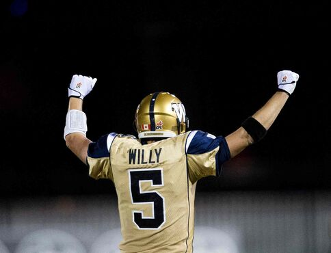 Winnipeg Blue Bombers' quarterback Drew Willy celebrates after throwing the game-tying, last-minute touchdown against the Hamilton Tiger-Cats during Thursday's game in Hamilton, Ont.
