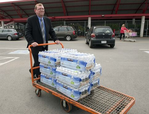 Sean Lynch Staunton stocks up on water for his hotel, Wednesday, May 22, 2013 in Montreal. Montreal has issued a boil-water advisory to a large swath of the city affecting over one million residents after a water-filtration station broke down. THE CANADIAN PRESS/Ryan Remiorz