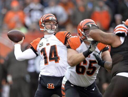 Cincinnati Bengals quarterback Andy Dalton passes against the Cleveland Browns in the first quarter of an NFL football game, Sunday, Dec. 14, 2014, in Cleveland. (AP Photo/David Richard)