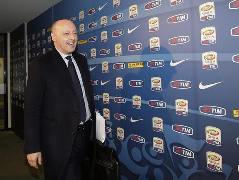 Juventus general director Giuseppe Marotta leaves the Lega calcio headquarter in Milan, Italy, Friday, March 6, 2015. Serie A has voted to provide crisis-hit Parma with a 5 million euro ($5.5 million) emergency fund to help the club finish the season.Sixteen of the 20 clubs in the top Italian league voted in favor of the measure Friday, three abstained and Cesena had the only vote against the move. The measure means last-place Parma should be able to play Atalanta on Sunday after its previous two matches were postponed indefinitely with the club unable to pay for basic services like security and electricity.(AP Photo/Luca Bruno)