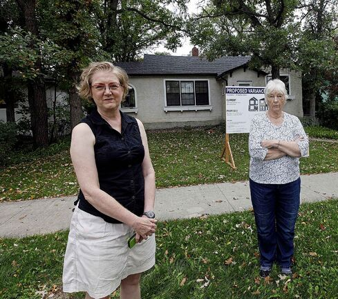PHIL HOSSACK / WINNIPEG FREE PRESS - Ann Hodges,  (front) and Ingrid Lee pose at concerned citizen 143 Renfrew St. (site of infill development they're concerned about). See Tessa's story. September 18, 2019.