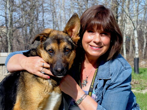 Christine Boult, director of development at the Winnipeg Humane Society, and nine-month-old Sophie. A German shepherd cross, Sophie is up for adoption.