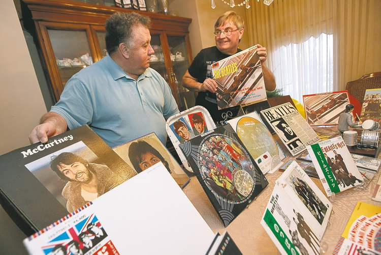 Richard Sturtz (right) and his brother-in-law, Alex Reid, with their Beatles collection.