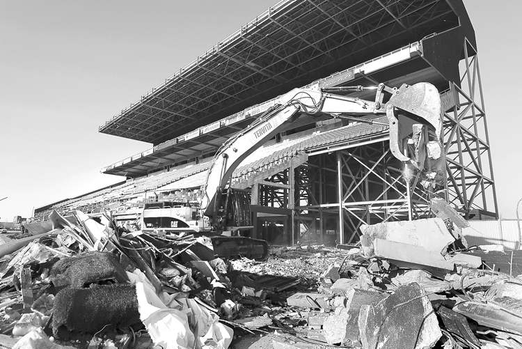 Crews demolish the Bombers' former home, Canad Inns Stadium, Tuesday. The team's move into Investors Group Field is, according to the only fan to ask a hard question at Tuesday night's fan forum, the only tangible sign of change from 2012.