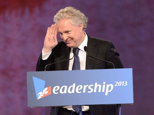 Former Quebec premier Jean Charest waves to the crowd during a tribute in his honour on March 16, 2013 in Montreal. THE CANADIAN PRESS/Ryan Remiorz