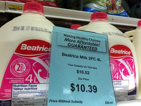A price tag lists the price and subsidy of a 4 L jug of milk at a grocery store in Iqaluit, Nunavut on Monday, December 8, 2014. THE CANADIAN PRESS/Sean Kilpatrick