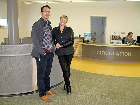 Amber Trails Community School principal Lorelei Bunkowsky (right) and vice-principal Fortunato Lim in the school's second-floor library.