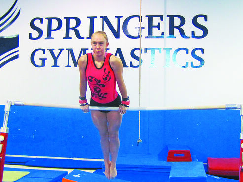 Molly Oswald of Springers Gymnastics Club practices her uneven bar routine to prepare for the biggest competition of her  career — the Canada Winter Games.