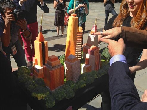 The New York skyline rendered in vegan-friendly vegetables attracts attention outside of New York's City Hall, where The People for the Ethical Treatment of Animals declared that New York is the nation's most vegan-friendly city, Wednesday Sept. 17, 2014. On hand for the City Hall presentation was the actor Alan Cumming who praised the city's commitment to vegan restaurants. (AP Photo/Jonathan Lemire)