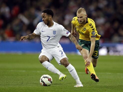 England's Raheem Sterling, left, is challenged by Lithuania's Vytautas Andriuskevicius during the Euro 2016 Group E qualifying soccer match between England and Lithuania at Wembley Stadium in London, Friday, March 27, 2015. (AP Photo/Matt Dunham)