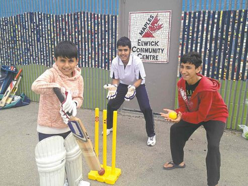 Three happy young cricketers look forward to learning more about the game this winter: Tariq Daoud (batting), Aziz Daoud (catching), and Aikram Hazrat (fielding).