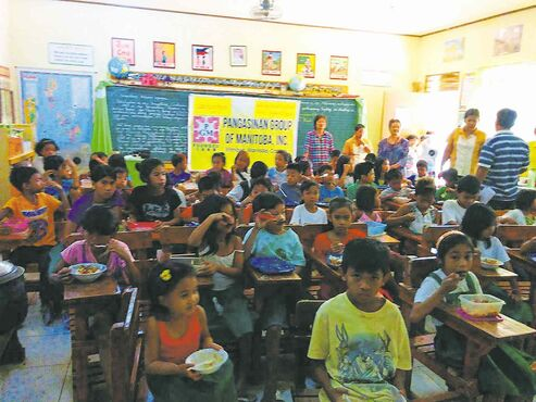 Students at Baloling Elementary School in Mapandan, Philippines, were recently beneficiaries of a school feeding program funded by the Pangasinan Group of Manitoba.