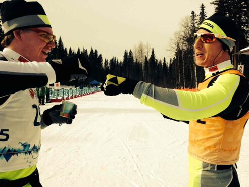 Jesse Bachinsky (left) fist bumps his guide, Brendan McDonald, after skiing to a silver medal in the five-kilometre mass start para male race. It's his second medal of the Canada Winter Games.