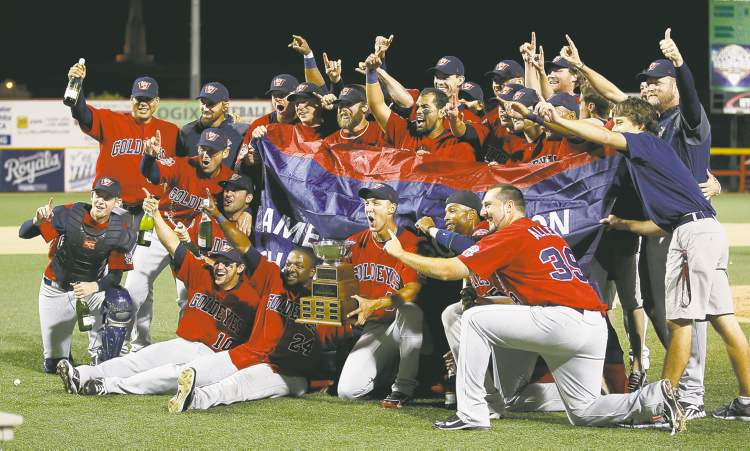 The Winnipeg Goldeyes pose with their trophy after winning the American Association Championship.