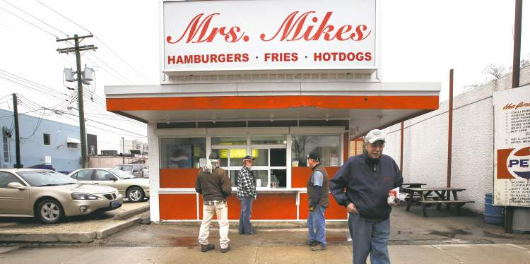 Mrs. Mikes burger stand has been a mainstay on Tache Avenue for decades, but these days it opens without founder Nick Mikos, who worked the grill from 1967 until his death last year.
