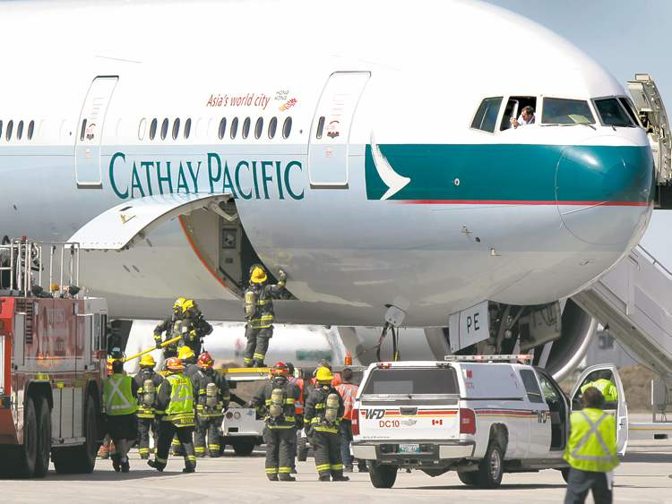 The Cathay Pacific Boeing 777 landed safely in Winnipeg after a false alarm suggested a fire had broken out in the cargo hold.