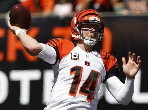 Cincinnati Bengals quarterback Andy Dalton passes against the Atlanta Falcons in the second half of an NFL football game, Sunday, Sept. 14, 2014, in Cincinnati. (AP Photo/Frank Victores)