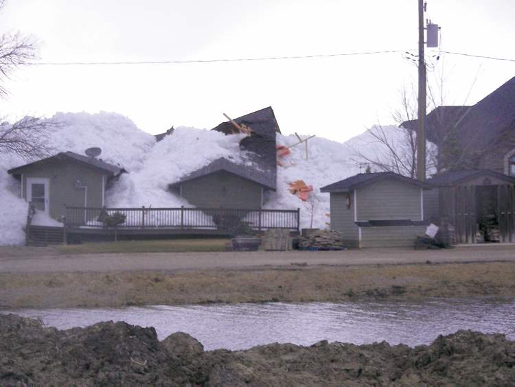 PHOTO BY RADIO STATION CKDMHouses on Lake Dauphin�s Ochre Beach were crushed by the sudden onslaught of ice off the lake Friday evening.