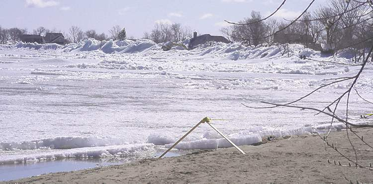 PHOTO BY RADIO STATION CKDMA view of the ice pushed ashore off Dauphin Lake by strong winds Friday evening and the houses it crushed.