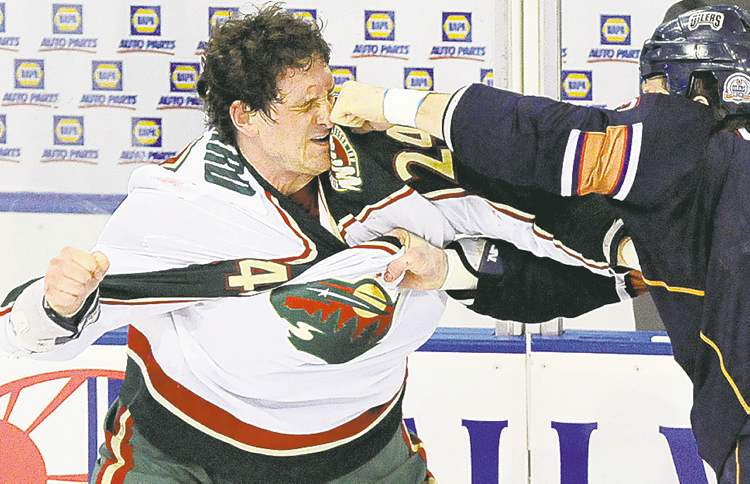 Jimmy Jeong / the associated press archivesDerek Boogaard (left) gets into it with Edmonton Oilers left-wing Steve MacIntyre in a 2009 game.